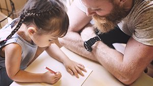 Father and daughter coloring thanks to child custody rights