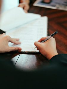 Person signing prenuptial agreement
